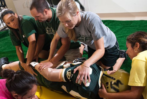 USF athletic trainers tending to an athlete
