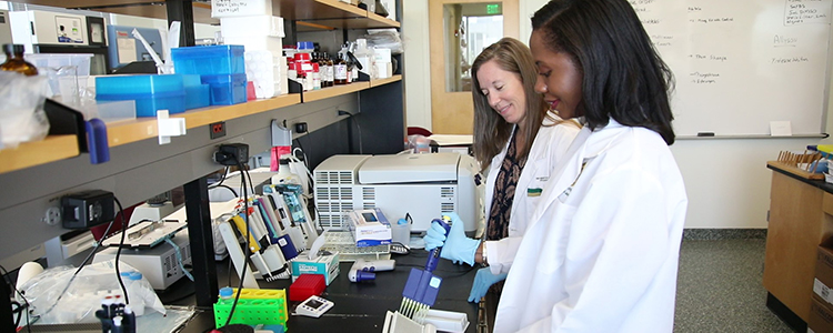 Dr. Lakeshia Cousin and Dr. Allyson Duffy in the biobehavioral lab.