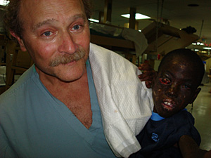 Dr. Charles Slonim with patient in Haiti
