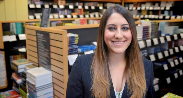 female graduate student in usf health bookstore